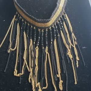 Chocker with extension. Black and gold fringe